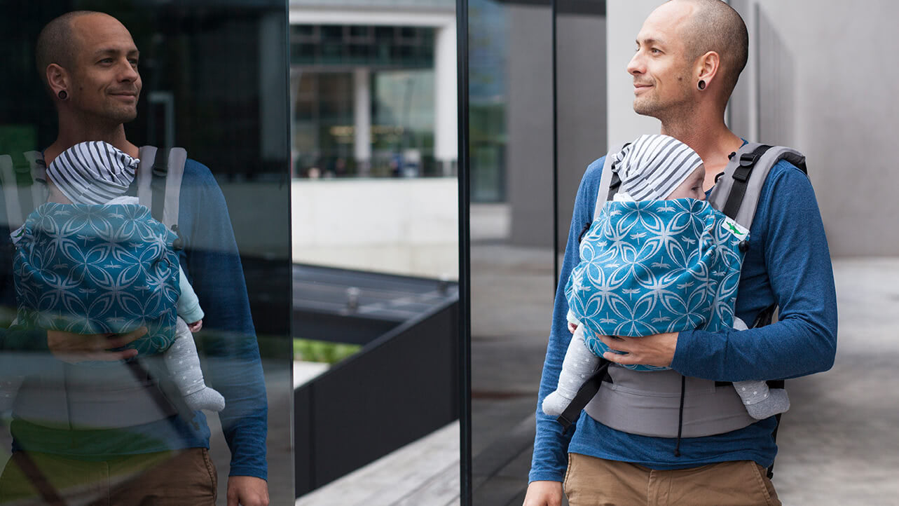 Babywearing Dad - carrying his little one in front carry in a Buzzidil SSC